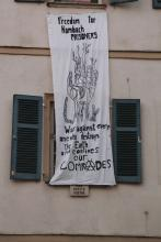 Banner saying freedom for Hambach prisoners, war against everyone who destroys the earth and confines our comrades